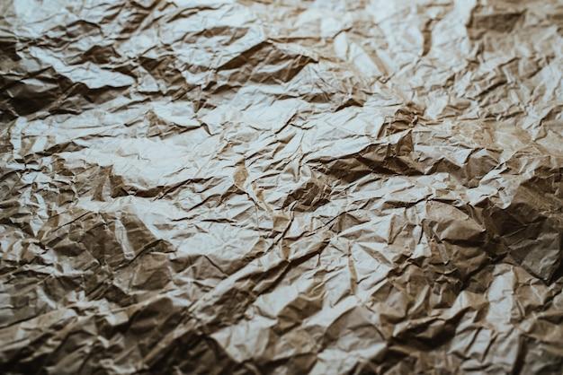 Verfrommeld en geëxpandeerd papier met natuurlijke verpakkingstextuur.