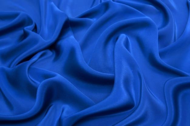 Verfrommeld gebreide donkerblauwe stof.