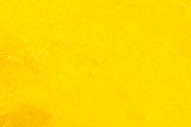Verfrommeld geel papier achtergrond. echte macro gehavende textuur. close-up foto.