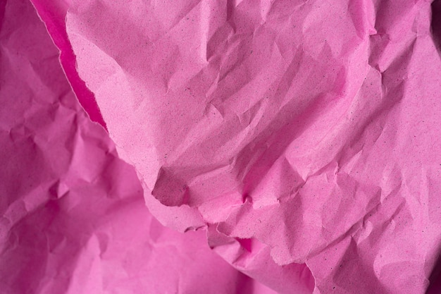 Verfrommeld kringloop roze document achtergrond. roze papier verfrommeld textuur voor achtergrond