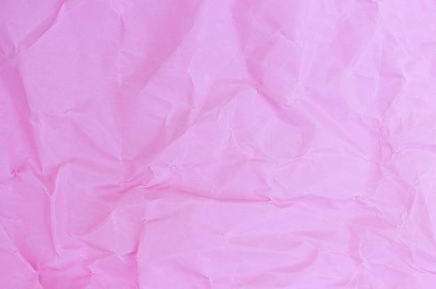 Verfrommeld papier roze pastel kleuren, textuur, achtergrond