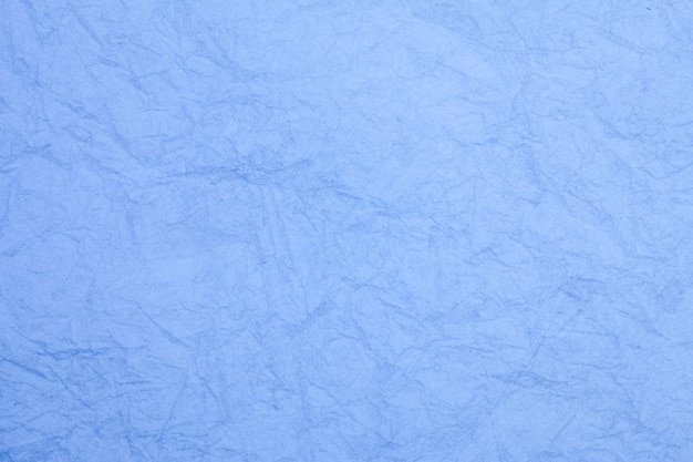 Verfrommeld vintage blauw papier getextureerde verouderde achtergrond.