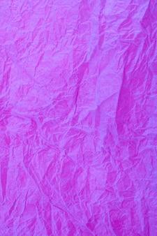 Verfrommeld vintage paars papier getextureerde verouderde achtergrond.