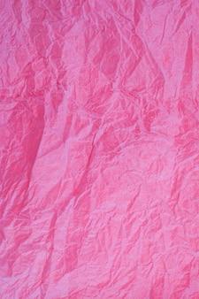 Verfrommeld vintage rood papier getextureerde verouderde achtergrond.