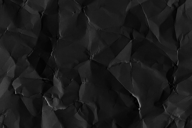 Verfrommeld zwart papier getextureerde achtergrond