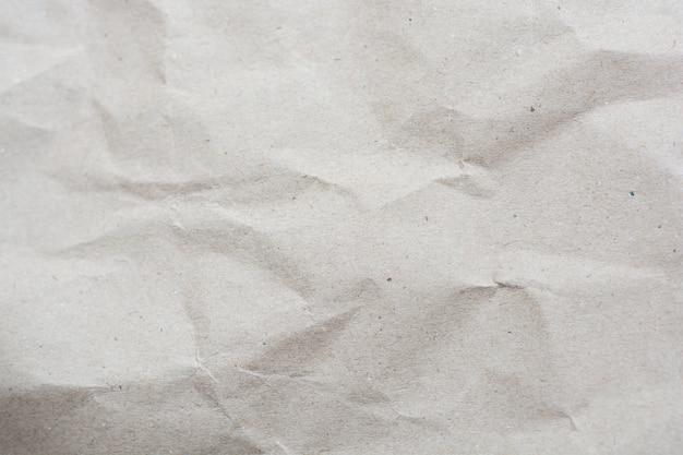 Verfrommelde crème kleur toon papier patroon textuur achtergrond