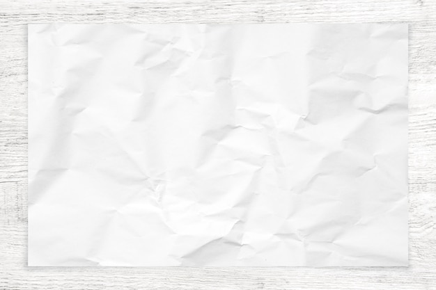 Verfrommelde document textuur op witte houten achtergrond.