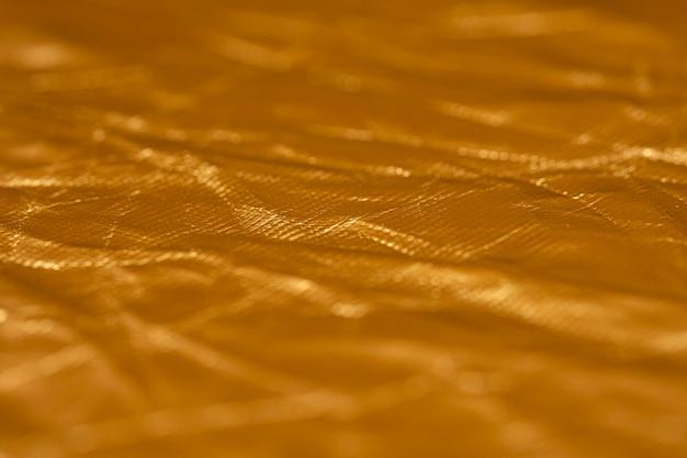 Verfrommelde gouden folie achtergrond