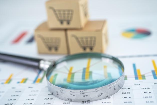 Vergrootglas en winkelwagentje-logo op doos met grafiekachtergrond