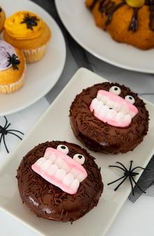 Vergrote weergave van halloween donuts concept