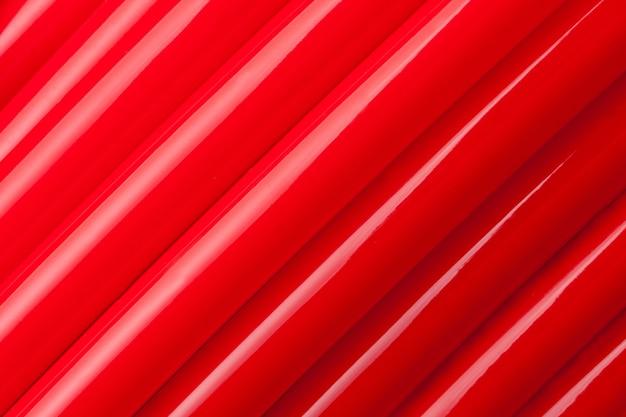 Vergrote weergave van rode waterleidingen. achtergrond of textuur
