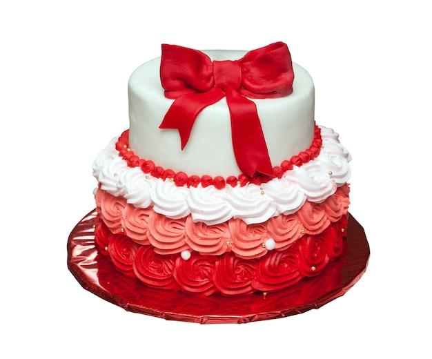 Verjaardagstaart met strik bovenop geïsoleerd op wit