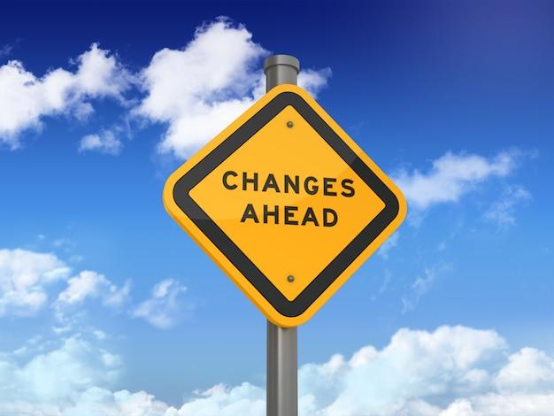 Verkeersbord met veranderingen vooruit woorden op blauwe hemel