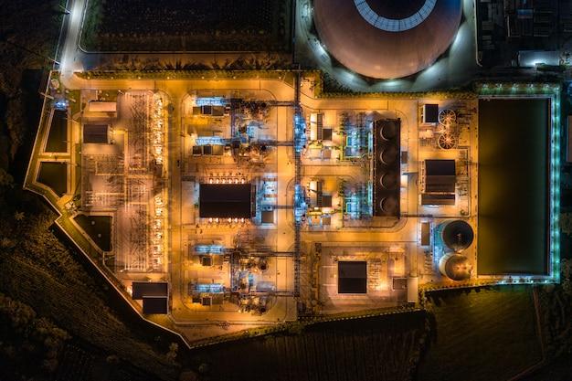 Verlichting van elektriciteitscentrales, 's nachts exportgerichte productie van papieren verpakkingen en golfkartonindustrie