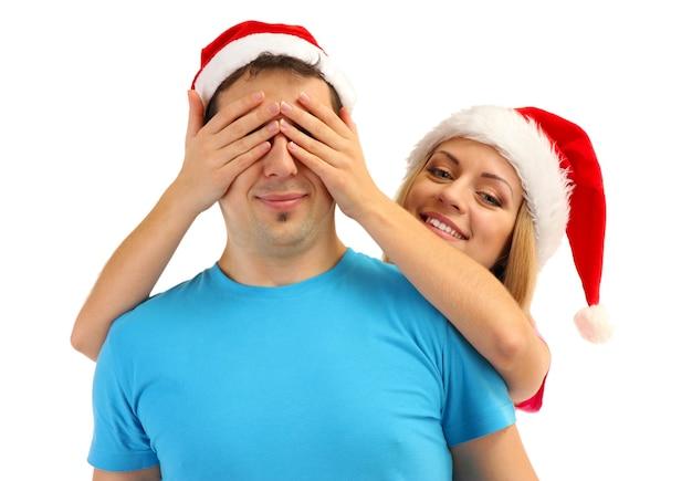 Verliefde paar in kerstmutsen geïsoleerd op white