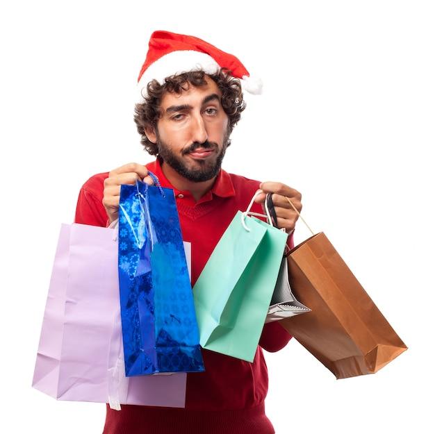 Vermoeide man met boodschappentassen