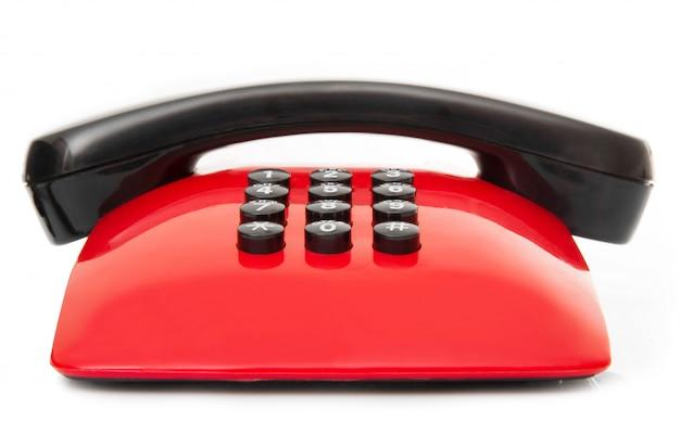 Verouderde telefoon op wit