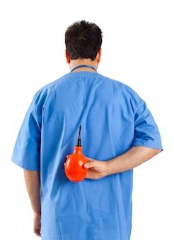 Verpleger met clyster
