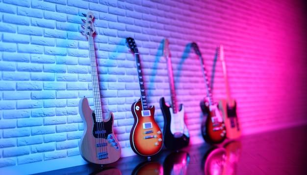 Verschillende elektrische gitaren tegen een bakstenen muur in neonlicht, 3d illustratie
