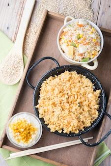 Verschillende rijstgerechten (paella met groenten, tomaat en rijstpudding)