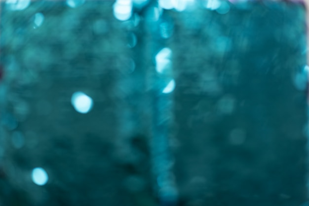 Verschillende schaduwen van turquoise pailletten vormen een abstracte getextureerde achtergrond