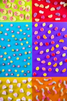 Verschillende snoepjes op veelkleurige achtergrond