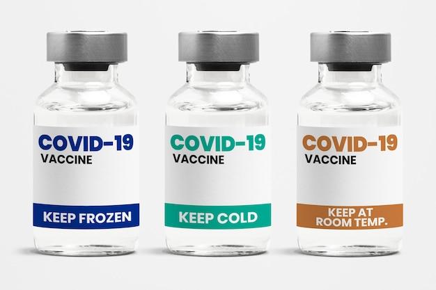 Verschillende soorten covid-19-vaccin in glazen flaconflessen met een label met verschillende opslagtemperatuurcondities