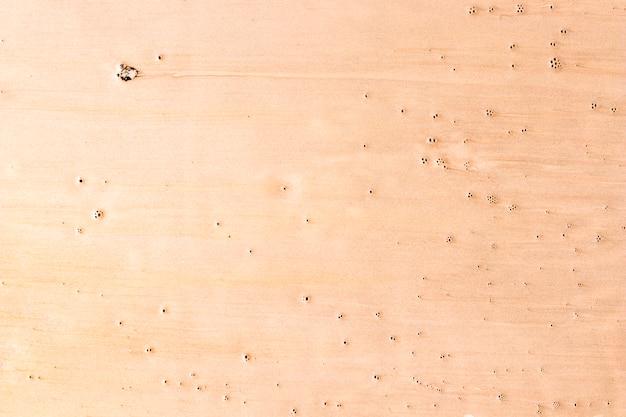 Verschillende tonen van cameo roze verf met vlekken
