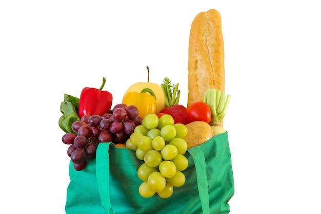 Verse groenten en fruit kruidenier in groene herbruikbare boodschappentas