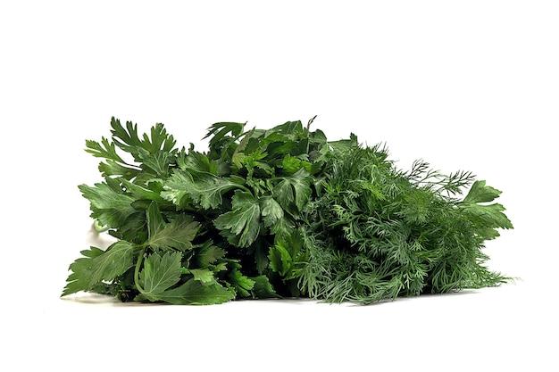 Verse peterselie greens en dille op een wit oppervlak