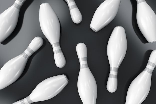 Verspreide bowling pinnen op het oppervlak.
