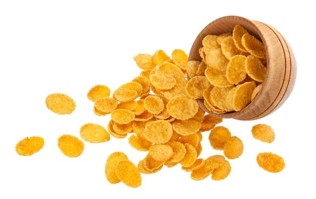 Verspreide cornflakes die op wit met het knippen van weg worden geïsoleerd