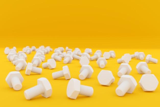Verspreide witte metaalschroeven die op geel worden geïsoleerd