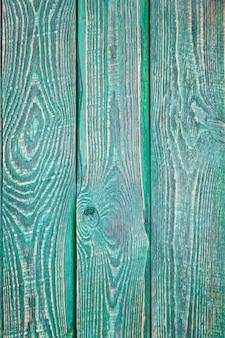 Verticale achtergrond van drie groene houten geweven planken.