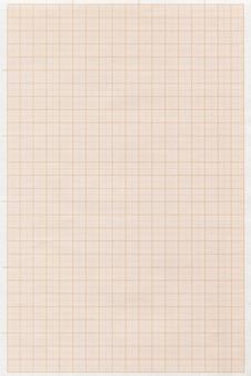Verticale afbeelding van een oranje millimeterpapier
