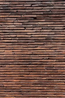 Verticale bruine bakstenen muur achtergrond