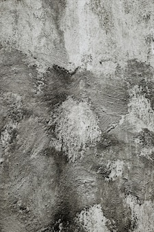 Verticale close-up van een grijze muur onder de lichten - cool fors