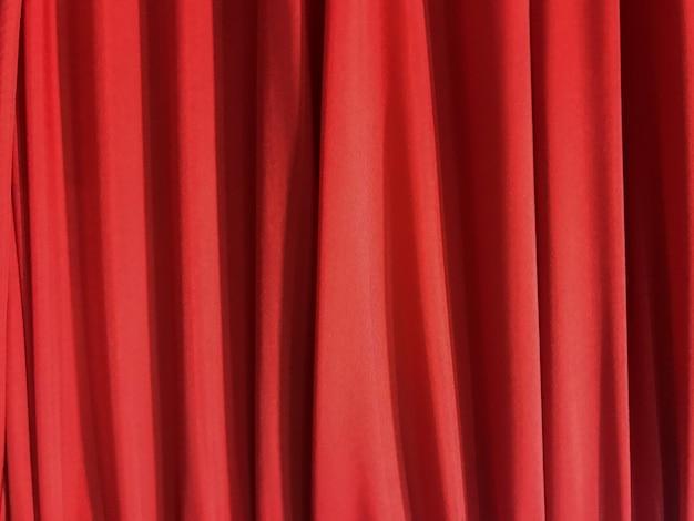 Verticale luxe wevende doek van de kromme rode stof texturebackground.