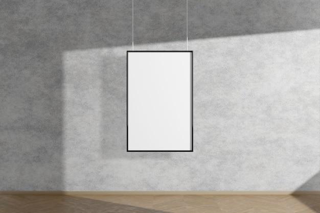 Verticale mock up fotolijst in zwart opknoping op betonnen muur eenvoudig interieur donkere kamer licht en schaduw van het raam. 3d-weergave