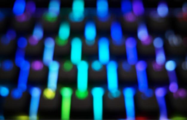 Verticale rgb bokeh van toetsenbordtoetsen achtergrond hd