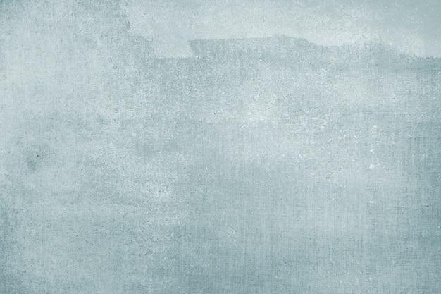 Vervaagde blauwe kleur op een canvas getextureerde achtergrond