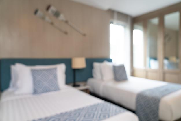 Vervagen van prachtige luxe hotelslaapkamer
