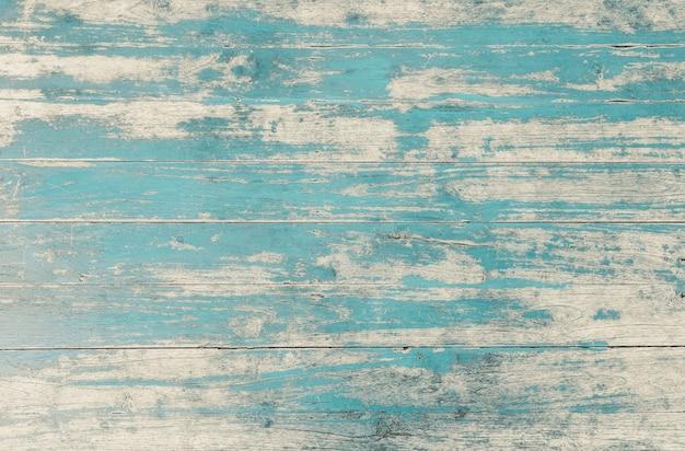 Verweerde blauw geschilderde houten muur achtergrond