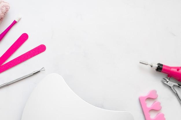 Verzorgingselementen voor platliggende nagels met kopie ruimte