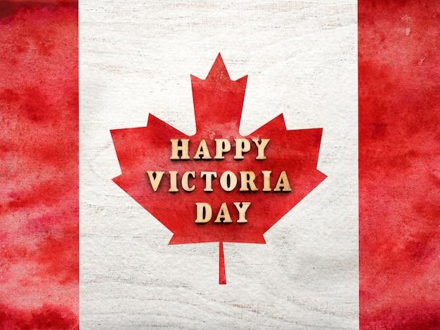 Victoria day-letters op de achtergrond van de canadese vlag