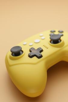 Videogames, entertainment thuis. draadloze joystick op een gele achtergrond.