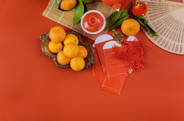 Vier aziatische festival decoraties chinees nieuwjaar met ceremonie thee veel mandarijnen oranje fruit