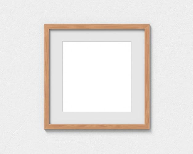 Vierkant houten lijstmodel met een grens die aan de muur hangt. lege basis voor afbeelding of tekst. 3d-weergave.