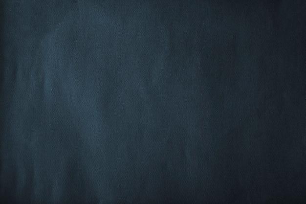 Vignet donkerblauw papier getextureerde achtergrond