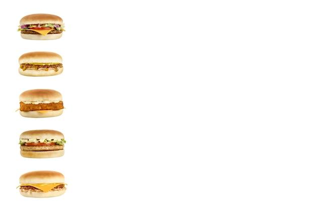 Vijf heerlijke hamburgers met verschillende vullingen verticaal.